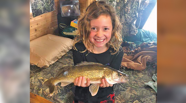 "LAKE OF THE WOODS FISHING TRIP. A mother and daughter team from Palmer reeled in several fish last weekend. Kaylee Achman (age 9) caught a 19"" walleye, as well as a 13"" walleye (which she threw back). Jennifer Achman caught a 23"" walleye, which they also threw back. The Achman family enjoys fishing at Lake of the Woods several weekends during the winter as a family. Kaylee is busy many  weekends with dance, and also enjoys skiing and hockey. (Submitted Photo)"