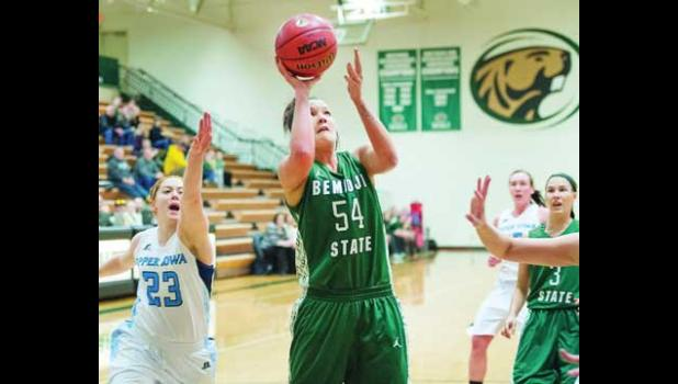 SENIOR BEAVER JESSIE ALTHOFF was named Bemidji's Athlete of the Week for two games in which she led the team in scoring. Althoff is a 2009 Becker High School graduate. Photo above: Althoff goes up for two of her 10 first-half points against Upper Iowa Saturday afternoon at BSU gymnasium.