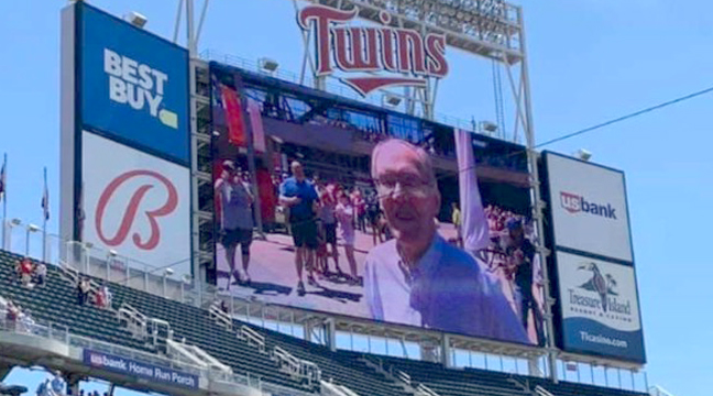 LOCAL PALMER MAN HONORED AT MN TWINS GAME. South Santiago Lutheran Church member Paul Fors was honored by the Minnesota Twins with raising the American Flag in center field at a recent Twins game. Fors is a decorated Korean War veteran who loves Jesus. He is described as a truly kind man, a terrific friend and a mainstay at the Tuesday morning Men's Bible Study held at SSLC.  (Submitted Photo.)