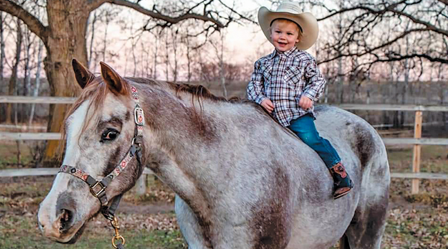 Shamba's son Charlie (Charge) Schmidt atop the very special horse.  (Submitted Photo).