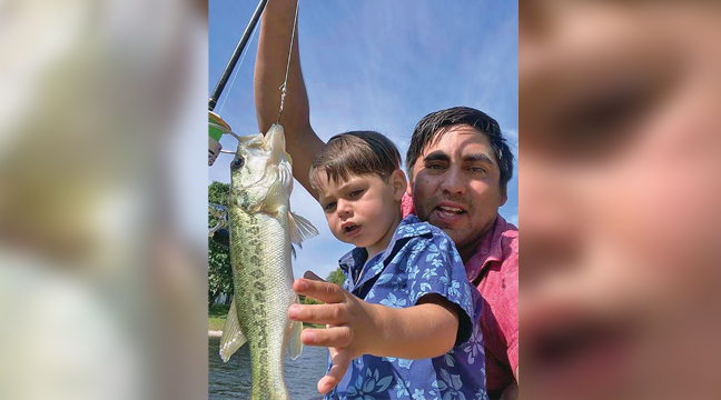 FATHER SON FISHING TIME. Juan and Arthur Weidmann reeled in a keeper last weekend. (Submitted photo).