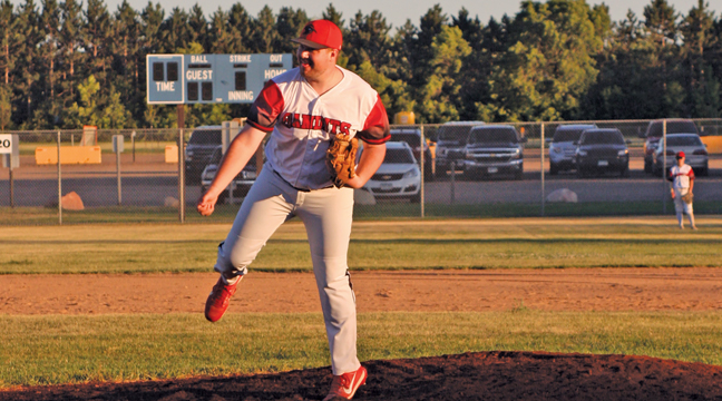 Bandit Manager Cole Hanson follows through on a pitch in the last inning of his team's win over the Becker Buzzards. (Patriot photo by Mark Kolbinger).