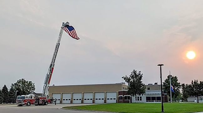 NEVER FORGET. The United States flag was flying high above the Becker Fire Department from a ladder truck in honor of the twentieth anniversary of 9/11, which was Saturday. Many businesses and organizations participated in the patriotic sentiment including the high school drivers who decorated their vehicles in their usual way.(Submitted Photo.)