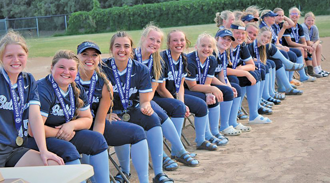 The state champion Becker Bulldog softball team members smiled for the camera at the welcome home ceremony held last week after the team's 4-0 win over Winona. (Submitted Photo).