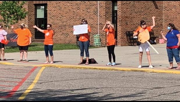 MANY OF CLEARVIEW'S TEACHERS AND STAFF held homemade signs during the parade, telling students they were missed and wishing them well. (Photo by Penny Leuthard)
