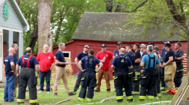 FIREFIGHTERS listened as the plan was explained before they started the fire. (Photo by Katherine Cantin.)