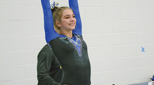 Britney Krumrei performed on vault and scored a 9.5 against the Princeton Tigers. (Photo by Paul Krumrei).