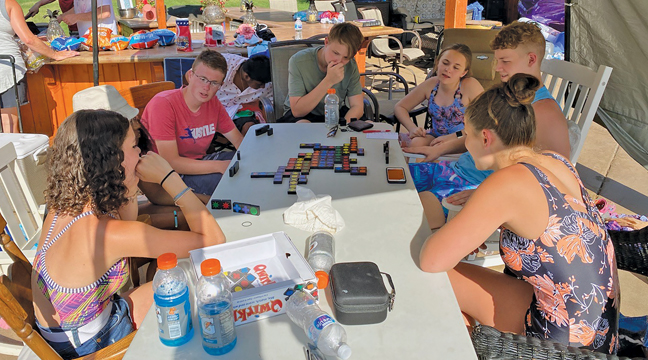 The  kids from BEFC rocked in their chairs, took dips in the pool, held a Bible study and played board games during their 24-hour pledge. (Submitted Photo)