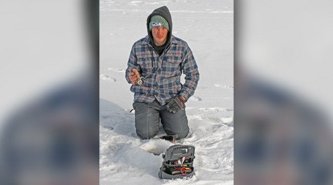 Cody Klatt, 8th grader at Becker Middle School, has been hitting the ice early and often in search of anything that bites.  Tuesday was his fourth straight day ice fishing.