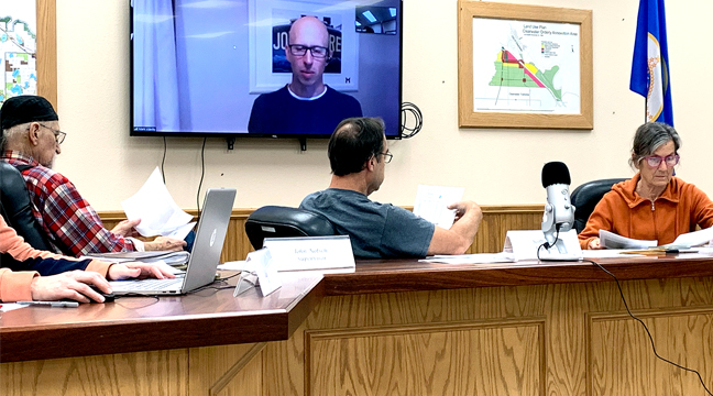 MEMBERS OF THE CLEARWATER TWP. BOARD talk remotely with Mark Vizecky during their October meeting. (Photo by Penny Leuthard.)