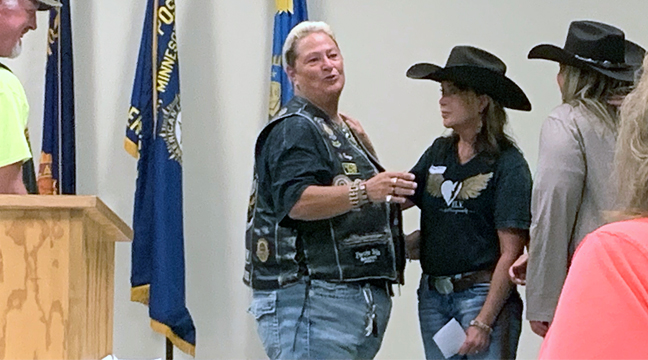 ANGEL REINS STABLE, an organization begun just a year ago, is presented a check by members of the Clearwater Legion Riders. (Photo by Penny Leuthard.)