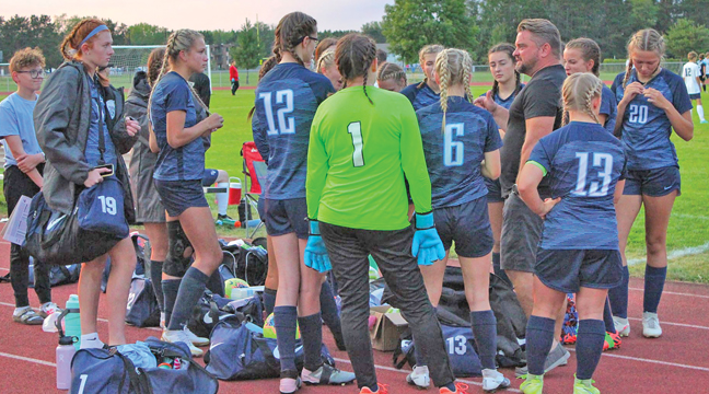 COACH STROM (R)  gave a pregame speech before the Big Lake match Sept. 14. (Submitted Photo)