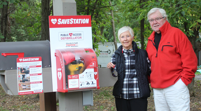 GARY AND JANE MARDSEN are pictured here with the SaveStation.  It can be accessed by the residents in the River Oaks development in Clear Lake and can save precious minutes in treating someone suffering from sudden cardiac arrest. (Photo by Mark Kolbinger).