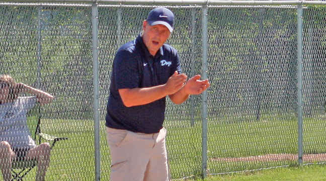 Jason Baune shouted encouragement to a batter during Tuesday's playoff victory, his 300th win as head coach of the Bulldog's program (Patriot photo by Mark Kolbinger).