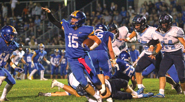 BIG LAKE QB Jaden Reifsteck tried to pull away from a Bulldog tackler during the first half of last Friday's game at home. (Patriot Photo by Bill Morgan)