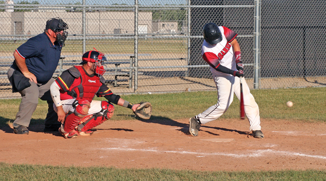 Bandit leadoff hitter Matt Krenz keeps his eye on this pitch as he was about to connect on a base hit in the fourth inning of the Becker baseball battle. (Patriot photo by Mark Kolbinger).
