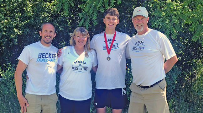 State bound.  Tyson Ricker (wearing his medal) qualified for the MN State Class AA Track Meet by placing 2nd in the Section 8AA 1600 meter run.  He is pictured with coaches Dustin Weege, Trish Reimer-Kealy and Paul Schmidt (Photo courtesy BHS Principal Dave Kreft).