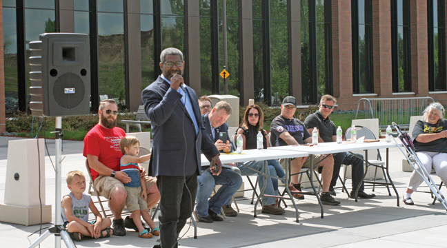 The Reverend Tim Christopher, Founder and President of the Shepherds Works organization, addressed the crowd and shared stories of his daily crusade to fight for his right to keep and bear arms as he tries to make a difference in the metro area (Patriot photo by Mark Kolbinger).