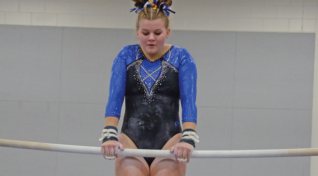 HANNAH HORVATH performed on bars at a recent Hornet meet. (Photo by Paul Krumrei).
