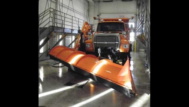 MIKE MOELLER of Sherburne County Public Works moves one of the snowplows at the maintenance facility on Hwy. 25 in Becker.
