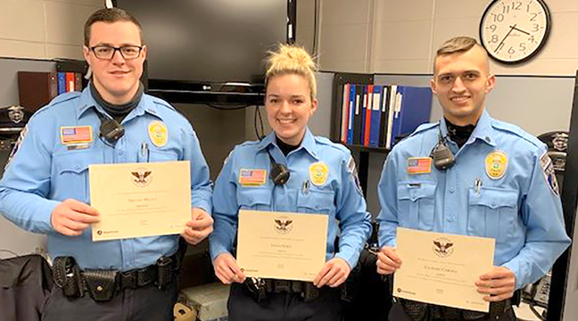 """Becker Police Reserves Receive Awards.  (L-R) Reserve Officer Tristan Mello, Reserve Lieutenant Jenna Voigt, and Reserve Sergeant Zach Cargill received 2020 Presidential Service Awards recently for their service to the Becker Police Department and City of Becker.  Both Voigt and Cargill received Gold service awards for volunteering over 700 and 600 hours respectively in 2020.  Mello received a Bronze award for volunteering over 160 hours in 2020.  Each received a certificate signifying their achievement along with a letter signed by the President, a pin and a challenge coin. This is the second such award for Voigt who last year received a Bronze award.  Per Chief Brent Baloun, """"I'm proud of our Reserve Officers and their commitment to our community.  They are a great asset to our police department and community."""" (Submitted photo.)"""