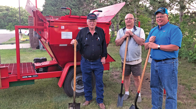 Palmer Twp. Board members (L to R) Richard Larson, Steve Demeules and Mike Ganz are pictured with a recently acquired tar trailer, allowing the supervisors to patch potholes with a high quality asphalt mix (Patriot photo by Mark Kolbinger).