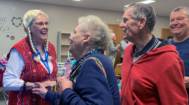 LENA (AKA LIZ SMITH) greets guests waiting in line for the Lutefisk & Swedish Meatball Dinner. (Photo by Penny Leuthard.)