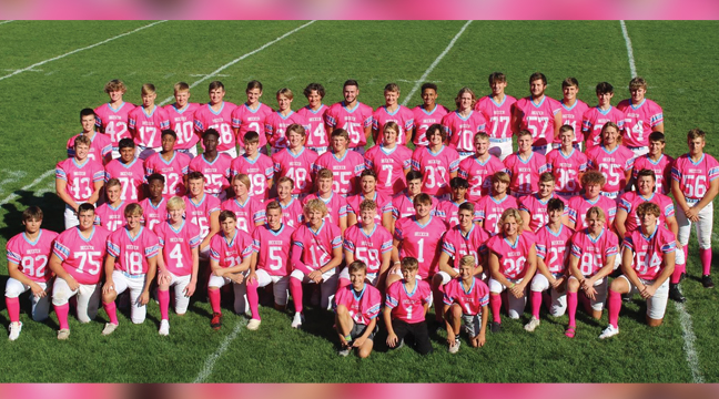 THE BECKER FOOTBALL TEAMS modeled their pink jerseys they planned to wear Friday night in their annual Tackle Cancer game at Eppard Field. (Photo by Sara Waytashek)