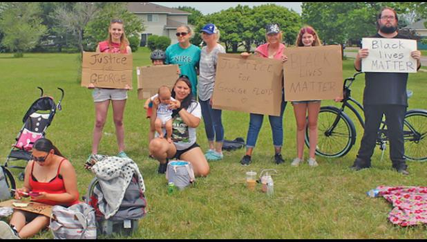 A SMALL CONTINGENT OF BECKER CITIZENS — which developed into a large contingent later in the day — took to the corner of Rolling Ridge Drive and Bank Street to get their message of injustice for George Floyd to the masses. (Photo by Penny Leuthard)