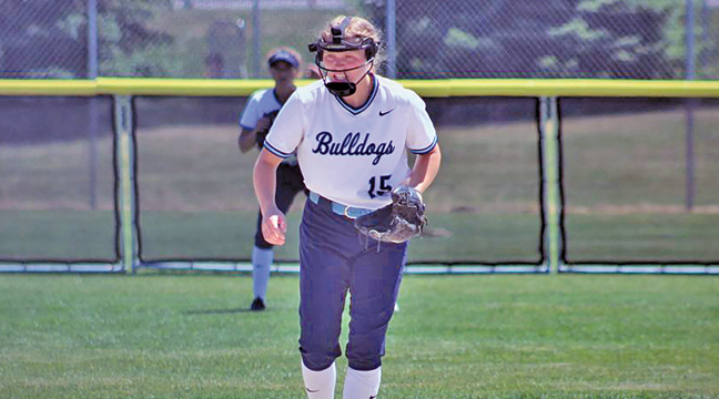 Bulldog Senior Krista Paulson kept a close eye on a pitch in the first inning of Becker's playoff win over Willmar.  Paulson would eventually walk and score for an early 1-0 Becker lead (Patriot photo by Mark Kolbinger).