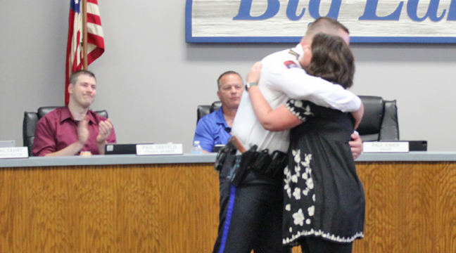 CHIEF MATT HAYEN hugged his wife, Molly, after she pinned on his new badge. (Photo by Katherine Cantin.)
