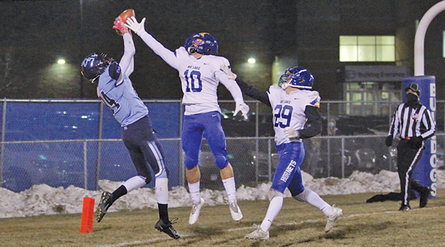 BECKER'S DEREK ROSKE reeled in this high pass in the back of the end zone for Becker's first score of the game. Roske is defended by Big Lake's Haden Thieke (#10) and Nick Merten  (#29). (Submitted Photo).