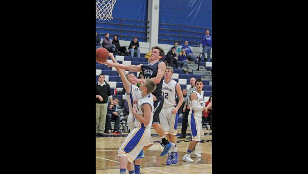BECKER SENIOR FORWARD ERIK TUNGLAND diced through the St. Cloud defense and put up a finger roll basket for two of his 10 points in Becker's 69-56 loss to the Crusaders Tuesday night at home.