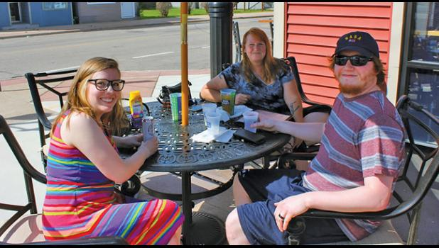 FINALLY OPEN! Patrons Beverly Capistrant (back), Austin Moberg (right) and Sarah Moberg (left) took to the patio at Charlie's Bar & Restaurant in Becker to enjoy outdoor seating for the first time since the COVID-19 pandemic. (Photos by Bill Morgan)