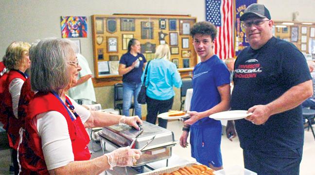JOHN JACKSON (R)  anad his son, Caleb Nau, 15, were served the Veteran's Free meal Saturday at Big Lake Twp. Hall by Legion Auxiliary member Judy Ranallo. Jackson is a retired Army Master Sergeant. (Patriot Photo by Bill Morgan)