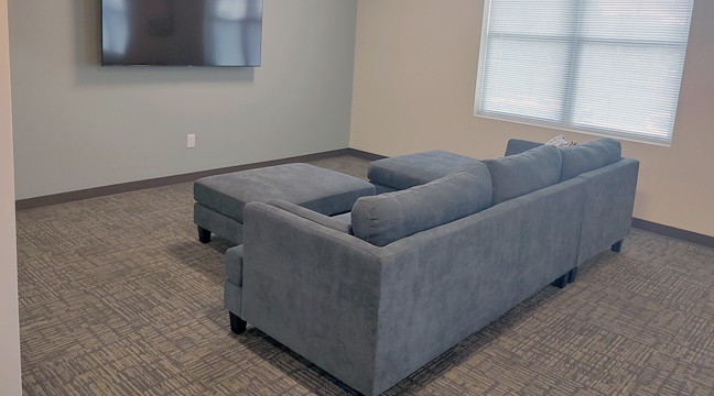 THE NEW NYSTROM & ASSOCIATES FACILITY is ready to accept patients wishing to recover from addiction. Left is a lounge area for residents, and right is one of the rooms available. (Photos by Katherine Cantin.)