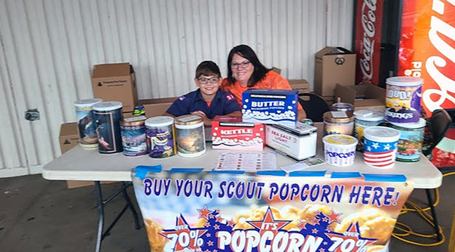 BECKER BOY SCOUT PACK 92 FUNDRAISER. Pictured is mother-son duo Marshall and Jean Kaproth selling a plethora of popcorn in a variety of scrumptious flavors outside at Becker Food Pride to support Becker Boy Scouts last weekend. (Photo by Mary Nehring.)