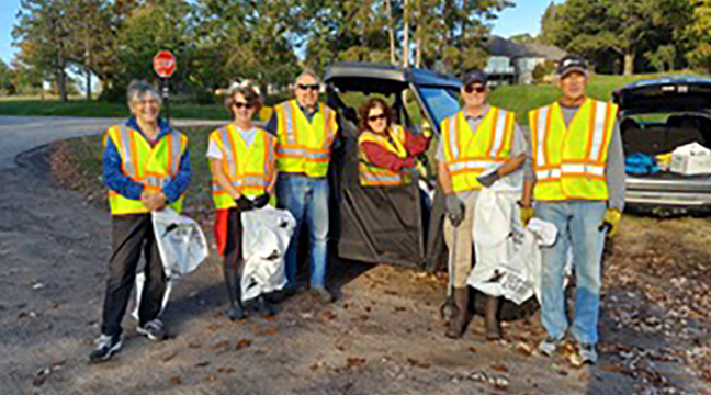 BELIA CLEANUP. Hannah Lakin, Jeff and Marie Johnson, John and Janine Smullen, Gordy Westerlind, and Lori Andreen all participated in the Big Eagle Lake Improvement Association cleanup along Co. Rd. 75. BELIA gave thanks to the volunteers, as well as Connexus Energy for providing the safety vests  and garbage bags, and to the Adopt-a-Highway program, with coordinator Marie Johnson.(Submitted photos.)